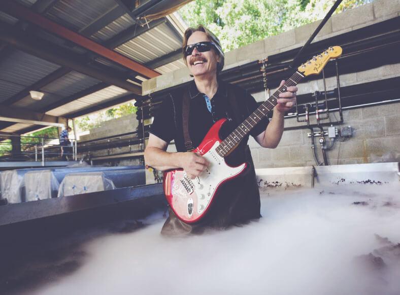Bob Cabral Wines - Bob playing guitar